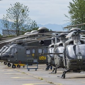 All Swiss helicopters standing in a row.