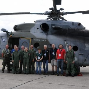 Group picture of the Czech measure team in front of their helicopter.