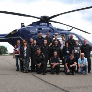 Group picture of the German measure team in front of their helicopter.