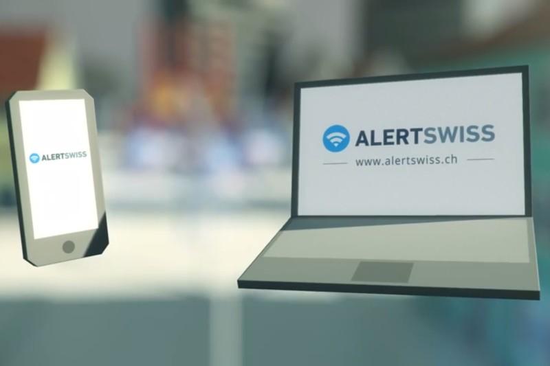 Das Bild zeigt ein Smartphone sowie ein Laptop. Auf beiden Bildschirmen ist das Alertswiss-Logo dargestellt.